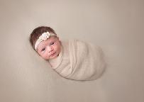 Photographer Akron Ohio posing newborn girl