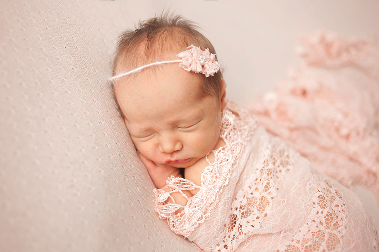posed baby newborn girl session tieback prop