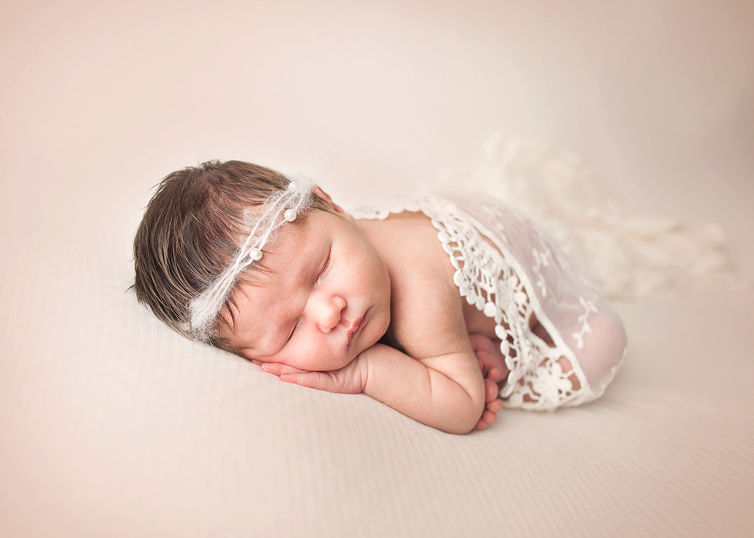 studio baby girl newborn session in lace romper tieback taco pose