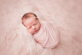Newborn photography wrapping techniques by top newborn photographer Chelsey Hill Photography