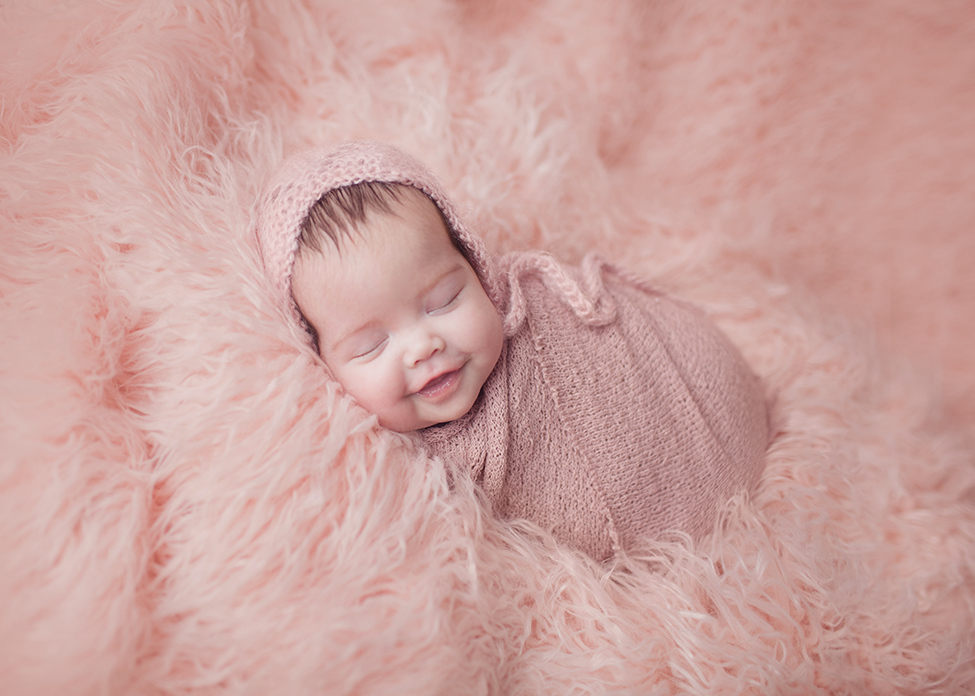 How to photograph newborn girl using wrapping techniques with matching bonnet and wrap by Chelsey Hill Photography