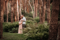 Best maternity photographer in the Cleveland and Akron area captures maternity session at magical forest with couple wearing blush maternity gown