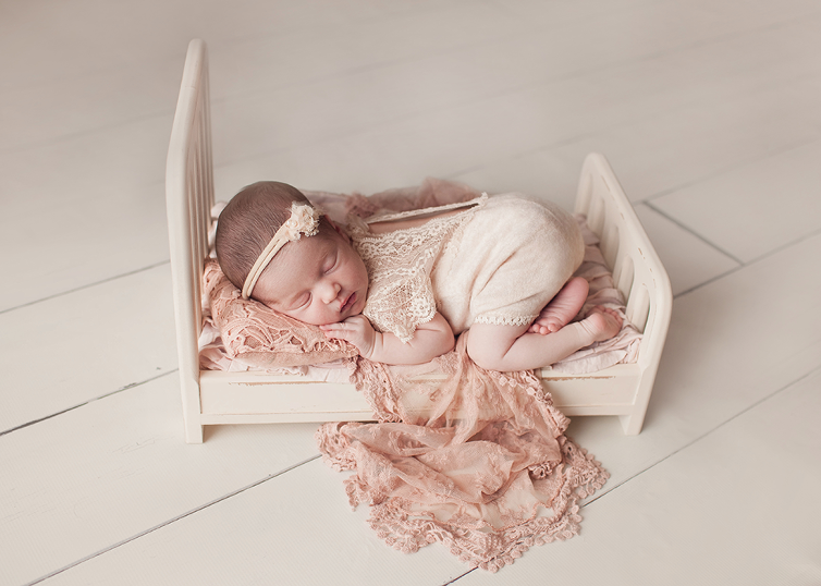Cleveland newborn photographer best time to schedule newborn portrait session to get sleepy poses