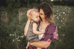 mom and son portrait in outdoor field wildflowers