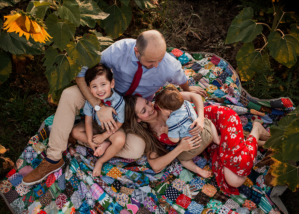 Cleveland family photographer captures family session at prayers from maria field of hope sunflower field at avon ohio