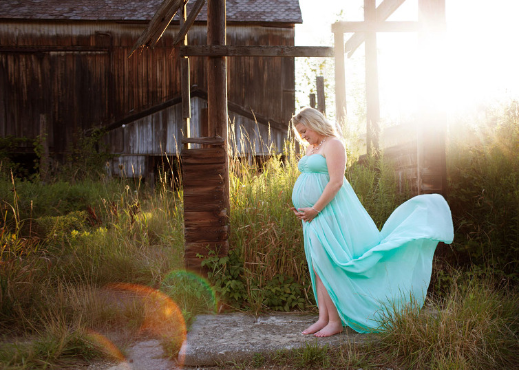 maternity session in outdoor field vintage barn sunflare