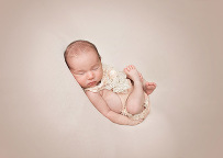 newborn girl posing in pink outfit