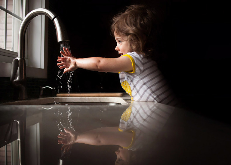 girls playing in kitchen sink