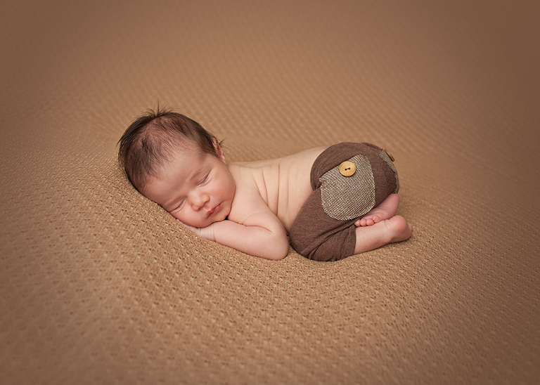 posed baby boy in brown outfit