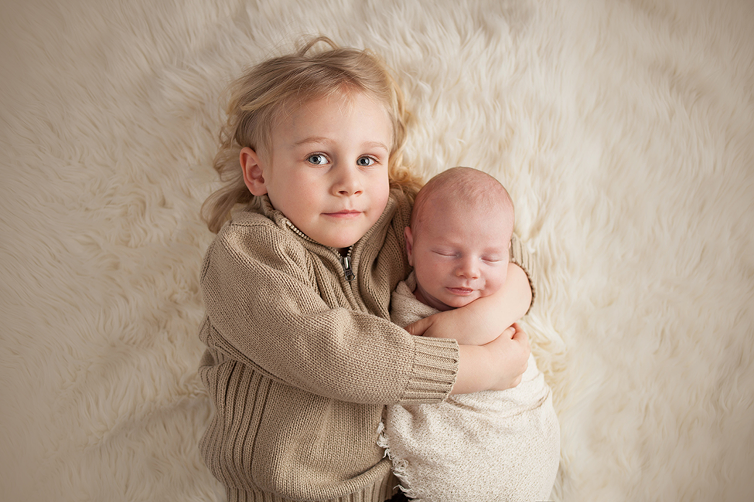 Cleveland newborn photographer posing baby and big brother