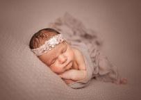 Newborn girl session posed in baby props