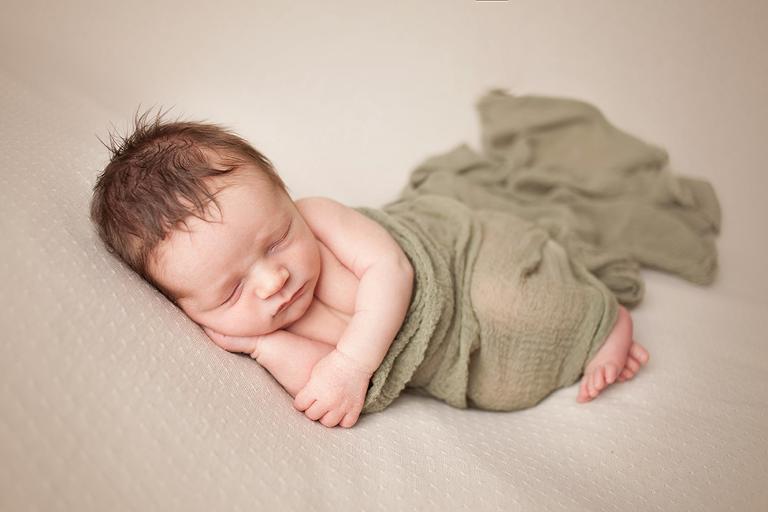 Posed newborn  boy session on beanbag