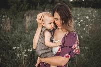 Mommy and me portrait in field sunset
