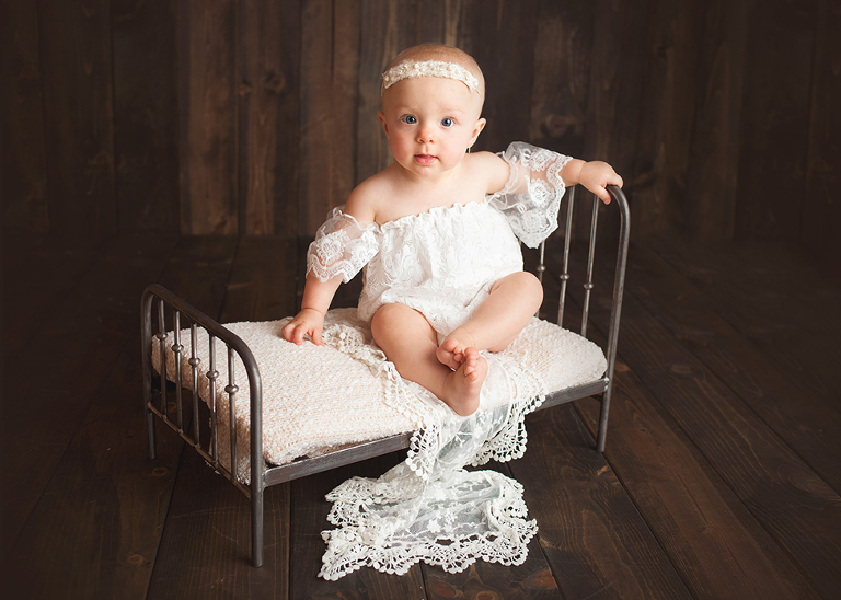 12 month girl milestone session in studio with lace dress