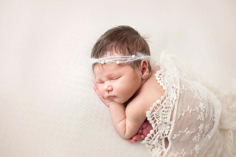 studio baby girl newborn session in lace romper tieback taco pose