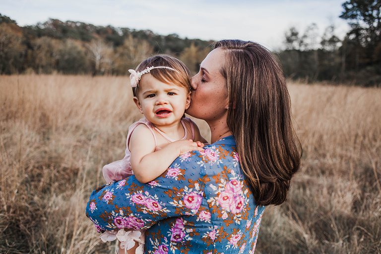 A stunning family session taken at a field in Cleveland Ohio of a modern family including two moms and their daughter by Chelsey Hill Photography